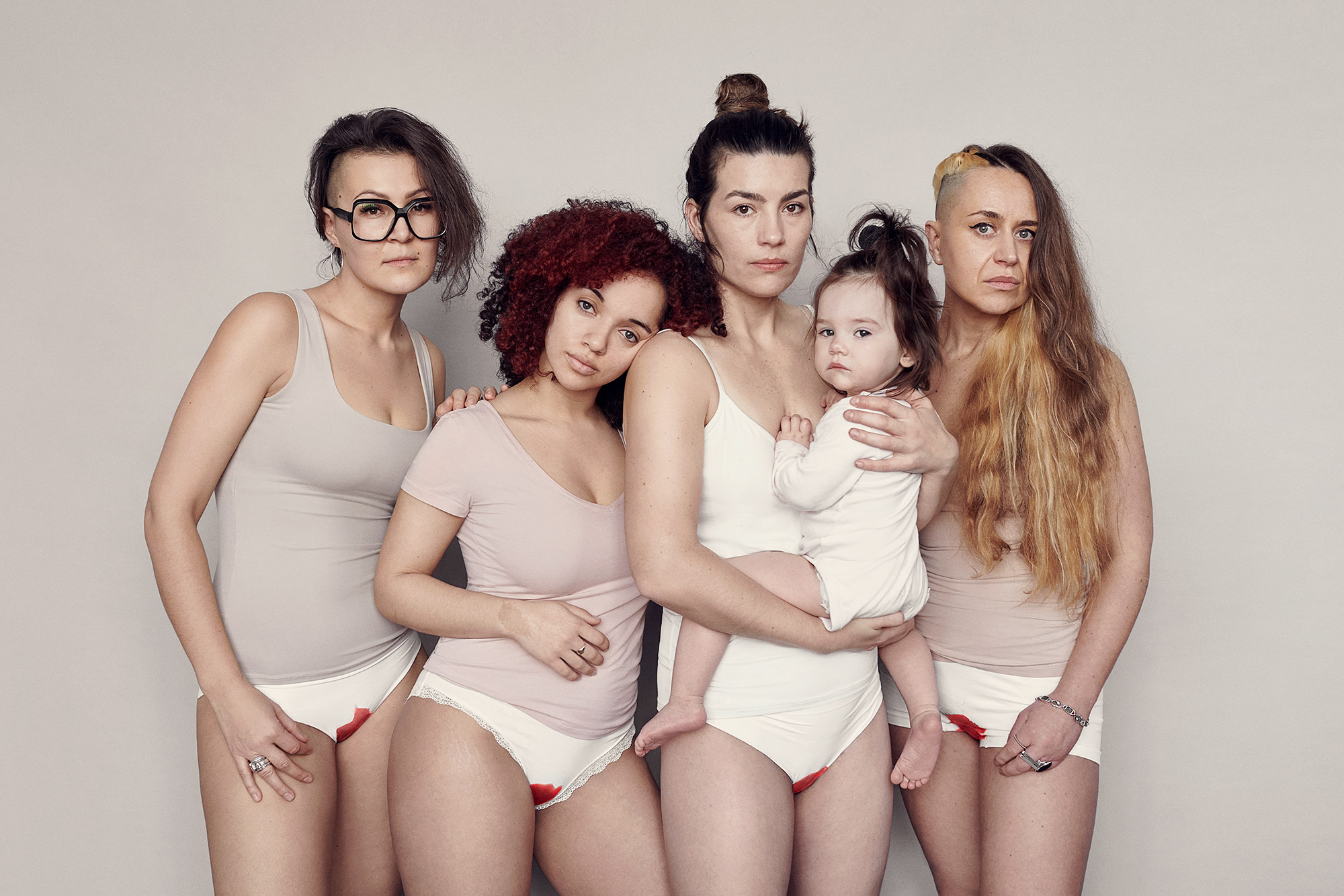 01-Group-shot-Portrait-photographer-Sane-Seven-asks-women-to-strip-to-their-underwear-for-a-project-about-period-shaming